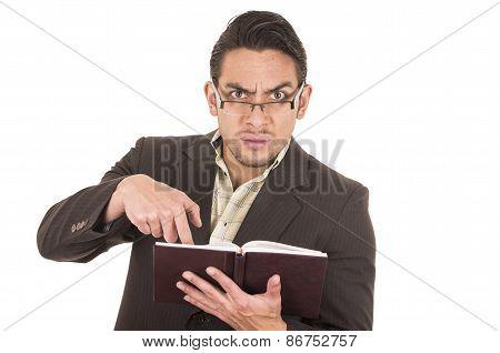 angry school teacher holding book