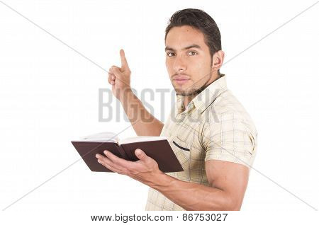 young handsome male teacher holding notebook