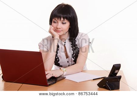 Office Employee Call-center Resting On Hand Looking At The Monitor