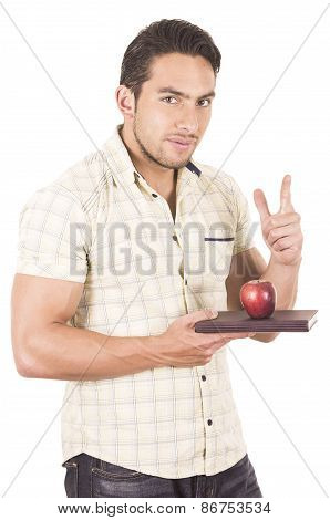 young hapy male teacher holding notebook and red apple