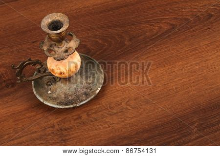 The Vintage Candlestick On The Wood