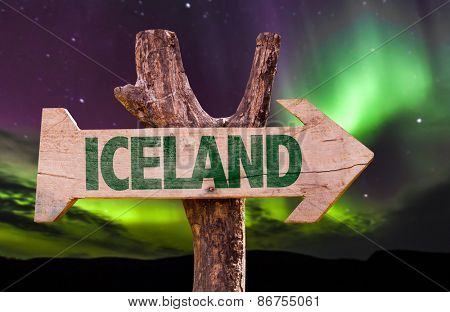 Iceland wooden sign with northern lights background