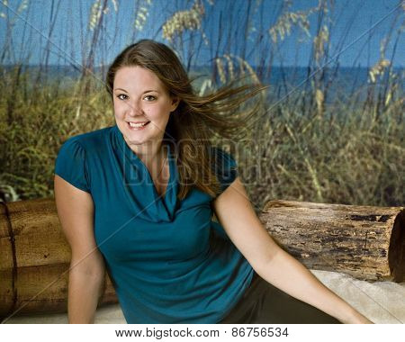 Pretty teen on a windy beach.
