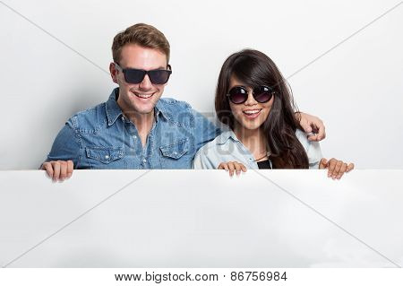Happy Young Multiculture Couple With While Blank Billboard Isolated