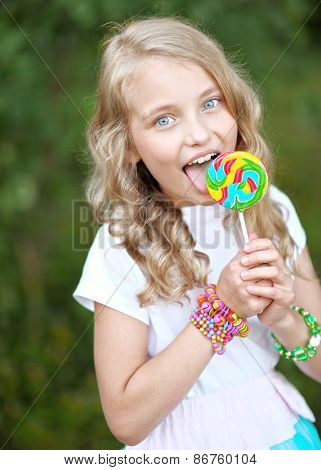 Portrait Of A Beautiful Girl With Candy