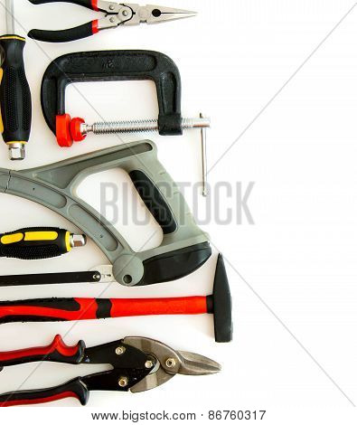 Many working tools - clamp, hammer and others on white background.