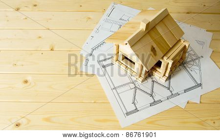 Many drawings for building and house on wooden background.