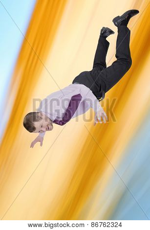 Businessman falling down with abstract background