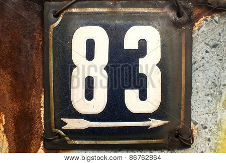 Weathered enamelled plate number 83