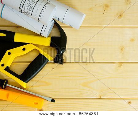Drawings for building,saw, hammer and others tools on wooden background.