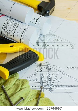 Repair work.. Drawings for building and working tools on wooden background.