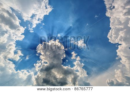 Blue Cloudy Sky With Sun Rays