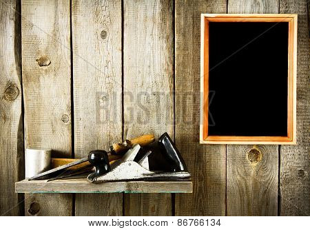 Many old tools and frame on a wooden background.