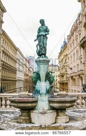 Female Statue With Swans In Vienna
