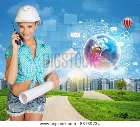 Builder talking on phone. Green hills, road, city and virtual elements