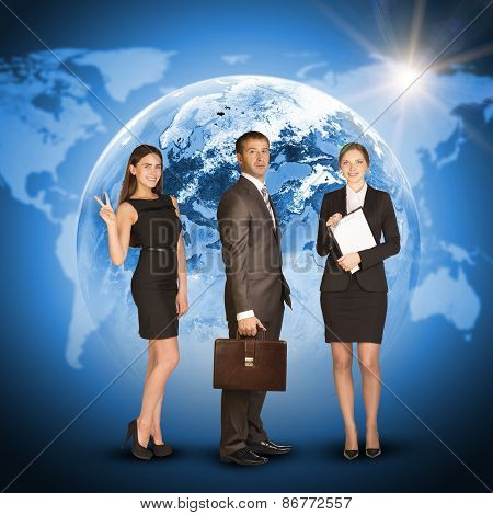 Three business person. Earth with world map and sun as backdrop