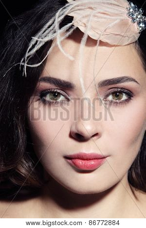 Close-up portrait of beautiful woman with fancy vintage hair accessory