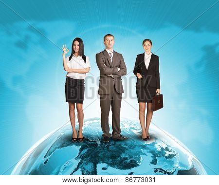 Business people in suit standing on Earth surface