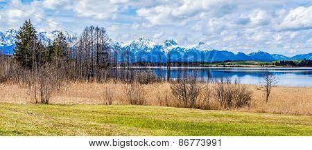Panorama of Bavarian Alps countryside lake landscape. Bavaria, Germany