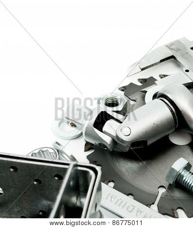 Metalwork. Spanner, ingot and others tools on white background.
