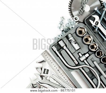 Metalwork. Box, saw, spanner and others tools on white background.