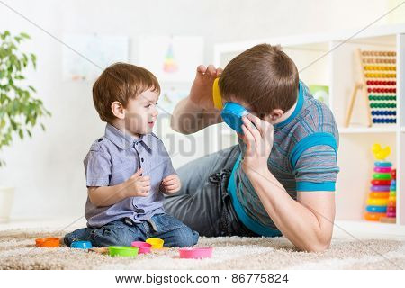 father with child son play