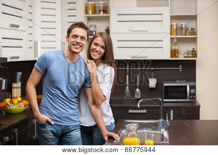 Young attractive couple in the kitchen