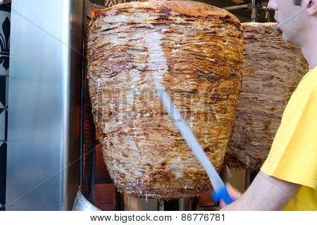 Chef Slicing Gyros Greek Fast Food
