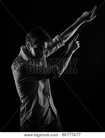 Dramatic Portrait Of A Man Showing Forefingers