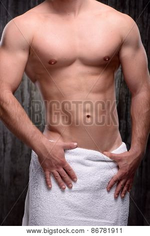 Close up of sportsman with towel on hips