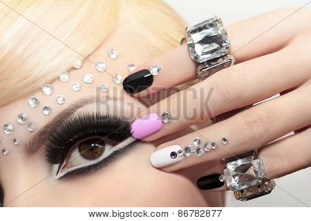 Fashion nails and makeup .