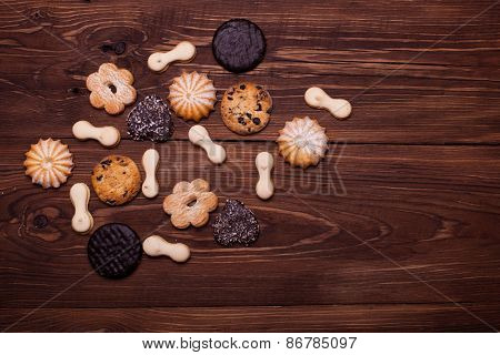 Various Cookies On The Wooden Table