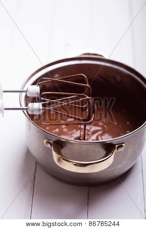 Chocolate Syrup Leaking From Kitchen Tool On Table