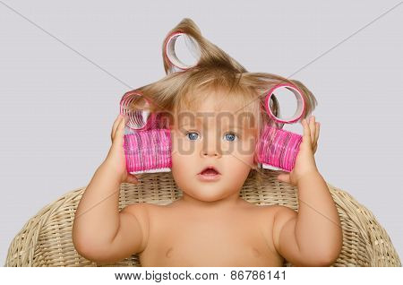 Little Attractive Girl With Hair Curlers