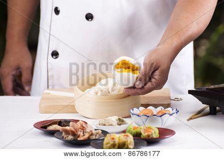 Hand Of Chefd Holding Steamed Dumpling Bun
