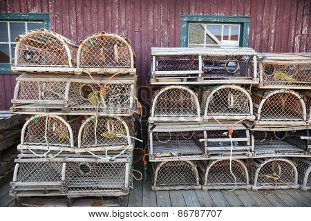 Stacks of wooden lobster traps in North Rustico, Prince Edward Island, Canada.
