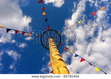 Flags On The Rope To A Pole In The Sky