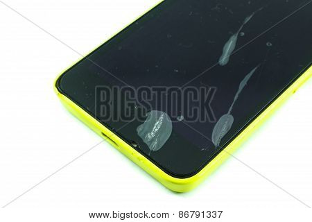 Black Mobile Phone With A Broken Screen And Dusty On An Isolated Background