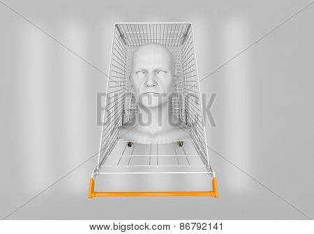 The man's head in the shopping cart on a gray background