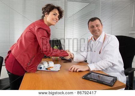 Doctor Receiving  A Woman Pharmaceutical Sales Representative