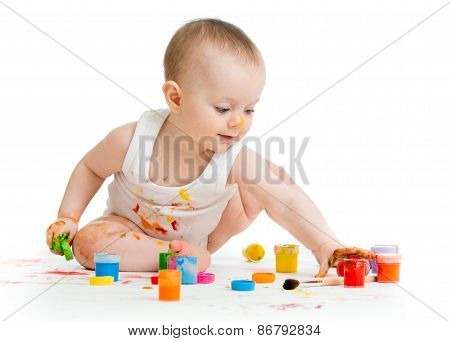 Little baby paint by his hands - on white background