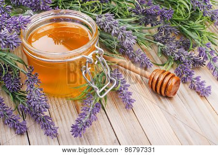 jar of liquid honey with lavender