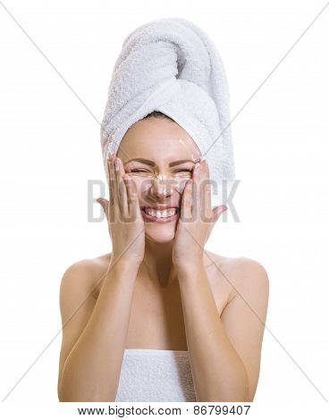 Funny Woman With Grimace Applaying Cream Or Moisturize On Her Face.expresive Female After Bathing,is