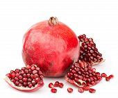 pic of whole-grain  - whole pomegranate with pieces and grains isolated on white background - JPG