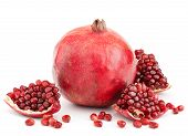 image of whole-grain  - whole pomegranate with pieces and grains isolated on white background - JPG
