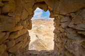 image of masada  - Window in a wall in the Columbarium tower on Masada in Israel - JPG