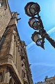 pic of lamp post  - Facade of cathedral and lamp post in Barcelona  - JPG