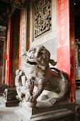 stock photo of stone sculpture  - Chinese stone lion statue sculpture at Chinese temple - JPG