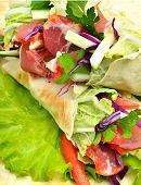 stock photo of turnip greens  - Tasty shawarma with fresh vegetables and meat lavash pita appetizeron green salad - JPG