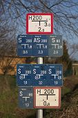 stock photo of underground water  - Collection of gate valve and water hydrant signs in Germany - JPG